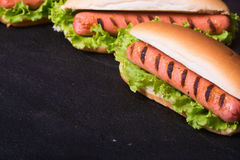 Barbecue Grilled Hot Dog. With Yellow Mustard on stone board Stock Photography