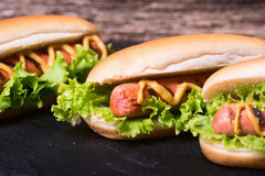 Barbecue Grilled Hot Dog. With Yellow Mustard on stone board Stock Photo