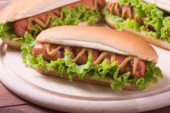 Barbecue Grilled Hot Dog. With Yellow Mustard on wooden board Stock Photo
