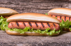 Barbecue Grilled Hot Dog. With Yellow Mustard on wooden board Stock Photos