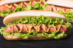 Barbecue Grilled Hot Dog. With Yellow Mustard on wooden board Stock Photography