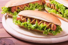 Barbecue Grilled Hot Dog. With Yellow Mustard on wooden board Royalty Free Stock Photography