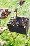 Barbecue grilled meat outdoor food hand cooking Royalty Free Stock Photos
