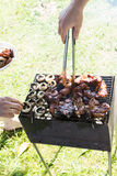 Barbecue grilled meat outdoor food hand cooking Royalty Free Stock Photo