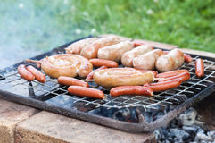Barbecue with grilled sausage on grill Royalty Free Stock Photo