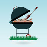 Barbecue. Grilled sausages on forks Royalty Free Stock Images