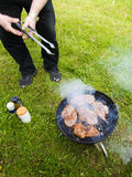 Barbecue. Grilling meat in the garden Stock Image