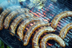 Barbecue. Grilling pork sausages on barbecue Royalty Free Stock Photo