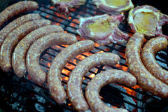 Barbecue. Grilling pork sausages on barbecue Stock Photography