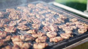 Barbecue grliling beef meatballs for picnic. Barbecue grliling meatballs for picnic stock footage