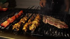 Barbecue grliling chicken on shish. Barbecue grliling chicken shish kebab stock video footage