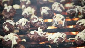Barbecue grliling meatballs. With cheese stock video footage