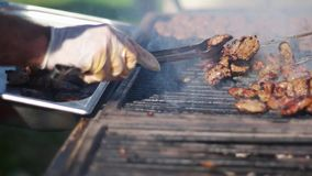 Barbecue grliling meatballs at outdoor activity picnic. Barbecue grliling meatball, festival food stock footage