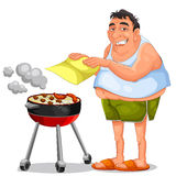Barbecue. Happy man doing a barbecue Stock Image