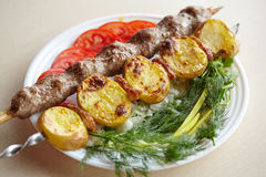 Barbecue Lula Kebab with minced meat, fresh vegetables and greens Stock Photo