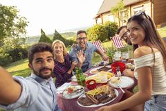 Barbecue lunch selfie. Group of friends having a backyard barbecue party, having fun taking selfies stock photos