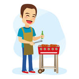 Barbecue Man. Young caucasian cheerful man cooking hamburger on barbecue grill stock illustration