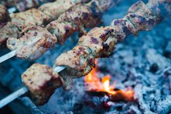 A barbecue meat on fire Royalty Free Stock Photo