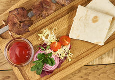 Barbecue meat with fresh vegetables Stock Image