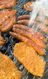Barbecue with meat on grill Stock Photos