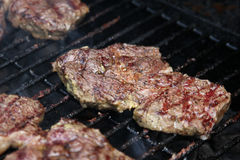 Barbecue meat on grill with smoke close-up Royalty Free Stock Image