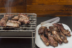 A barbecue. With meat and a plate with roast beef Royalty Free Stock Photography
