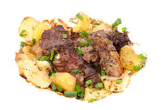 Barbecue meat with potato close-up Stock Image