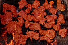 Barbecue meat. Put the mixed sauce of beef on the iron net roast Royalty Free Stock Images
