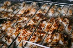 Beef steaks on the grill. Barbecue meat steaks on the grill with flames. Meat on the coals, barbecue close up Royalty Free Stock Photo