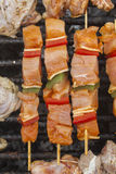 Barbecue meat on a sticks on a grill Royalty Free Stock Photo