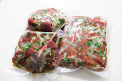Barbecue meat in vacuum marinade bag Royalty Free Stock Photos