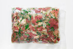 Barbecue meat in vacuum marinade bag Royalty Free Stock Photography