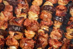 Barbecue from meat and vegetables on fire Stock Photography