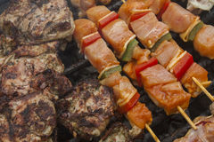 Barbecue meat with vegetables on a grill Royalty Free Stock Photography
