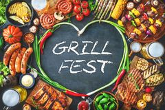 Grilled meat and vegetables on rustic stone plate Stock Images