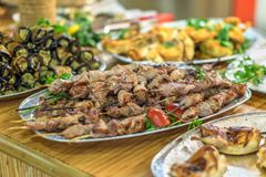 Barbecue and other dishes in the restaurant of oriental food stock image