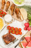 Barbecue party with beer, meat and vegetables Royalty Free Stock Photos