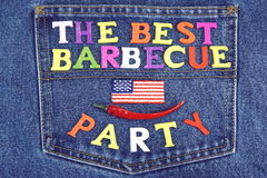 Barbecue Party Wood Sign On Blue Jeans With American Flag Stock Photo