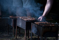 Barbecue photo. Photo with grill, sausage and other roasted meal Stock Photos