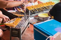 Barbecue pork on the grill cooking in Taling Chan Floating Markett at Bangkok, Thailand. Barbecue pork on the grill cooking in Taling Chan Floating Markett at stock images