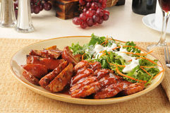 Barbecue pork with potatoes Stock Images