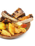 Barbecue Pork Ribs and Roasted Potato Stock Images