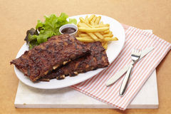 Barbecue pork ribs serve with french fried and salad Stock Photo
