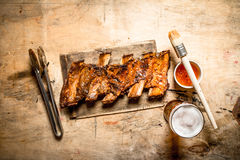 Barbecue pork ribs with tomato sauce and beer. Stock Photo