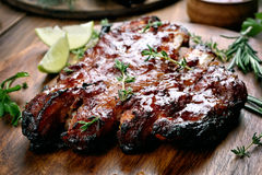 Barbecue pork ribs on wooden board Stock Photo