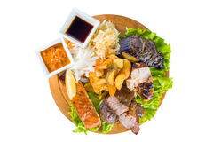 Barbecue pork, salmon steak, potatoes, salad and sauce Royalty Free Stock Images