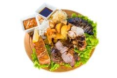 Barbecue pork, salmon steak, potatoes, salad and sauce Stock Photo