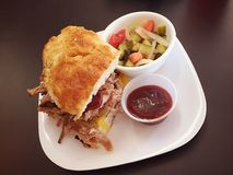 Barbecue pork sandwich and side vegetables. A barbecue pork sandwich and side of vegetables on a white plate Royalty Free Stock Photography