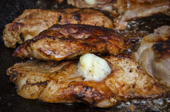 Barbecue with pork and sheep butter. Close up of a barbecue with pork and sheep butter Stock Image