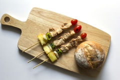 Barbecue pork stick and bread on wooden. top view Royalty Free Stock Photography